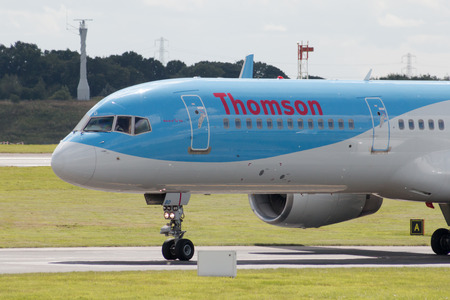 boeing: Thomson Airways Boeing 757 narrow-body passenger plane taxiing on Manchester International Airport taxiway. Editorial