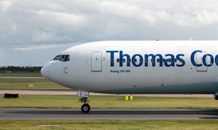 thomas: Thomas Cook Boeing 767 wide-body passenger plane taxiing on Manchester International Airport taxiway.