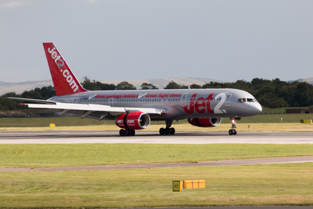 may fly: Jet2 Boeing 757 narrow-body passenger plane taxiing, Manchester International Airport, United Kingdom.