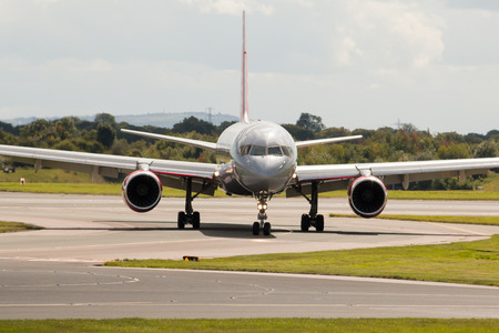 holiday budget: Jet2 Boeing 757 narrow-body passenger plane taxiing, Manchester International Airport, United Kingdom.
