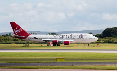 boeing: Virgin Atlantic Boeing 747 wide-body passenger plane Ruby Tuesday taxiing on Manchester International Airport taxiway. Editorial