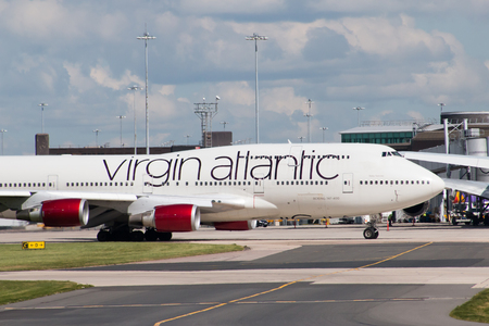 boeing 747: Virgin Atlantic Boeing 747 wide-body passenger plane Ruby Tuesday taxiing on Manchester International Airport taxiway. Editoriali