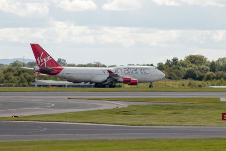 boeing 747: Virgin Atlantic Boeing 747 wide-body passenger plane Ruby Tuesday taking off from Manchester International Airport runway.