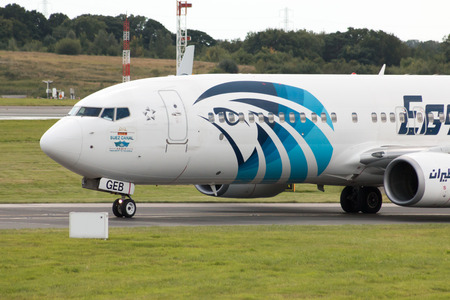boeing: EgyptAir Boeing 737 narrow-body passenger plane SU-GEB taxiing on Manchester International Airport taxiway. Editorial