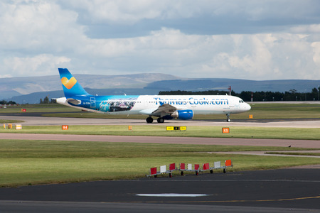 thomas: Thomas Cook Airlines Boeing 757 narrow-body passenger plane G-TCDA taxiing on Manchester International Airport taxiway. Editorial