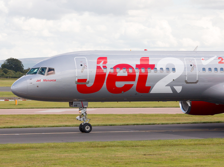 holiday budget: Jet2 Boeing 757 narrow-body passenger plane Jet2Menorca taxiing on Manchester International Airport taxiway. Editorial