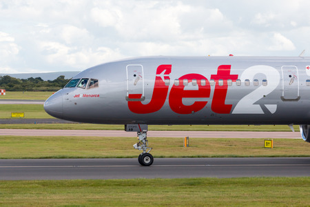 may fly: Jet2 Boeing 757 narrow-body passenger plane Jet2Menorca taxiing on Manchester International Airport taxiway. Editorial