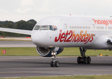 boeing: Jet2 Holidays Boeing 757 narrow-body passenger plane taxiing on Manchester International Airport taxiway after landing.