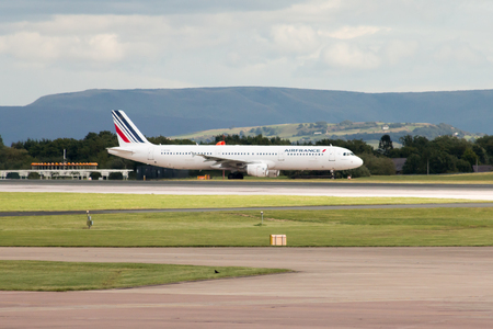 departing: Air France Airbus A321 narrow-body passenger plane F-GTAS departing from Manchester International Airport runway. Editorial