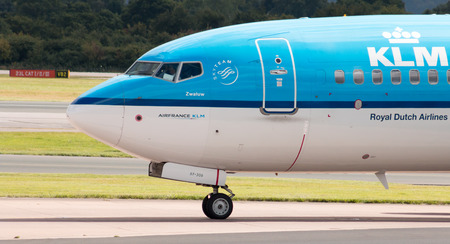 klm: KLM Royal Dutch Airlines Boeing 737 narrow-body passenger plane PH-BXF taxiing on Manchester International Airport taxiway.