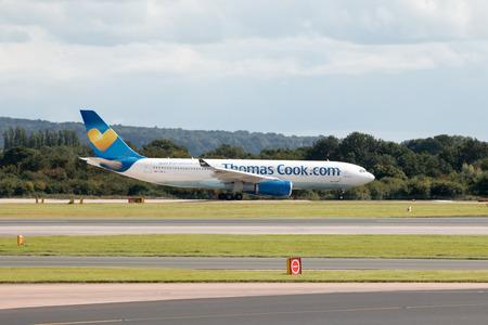 departing: Thomson Airways Boeing 757 narrow-body passenger plane G-OOBD departing from Manchester International Airport runway. Editorial