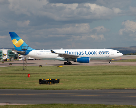 thomas: Thomas Cook Airbus A330 wide-body passenger plane taxiing on Manchester International Airport tarmac. Editorial