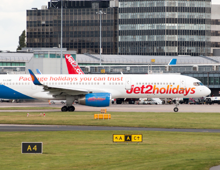 may fly: Jet2Holidays Boeing 757 narrow-body passenger plane G-LSAE taxiing on Manchester International Airport tarmac.