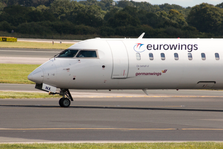 bombardier: Eurowings Bombardier CRJ900 NextGen passenger plane taxiing on Manchester International Airport after landing.