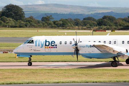 turboprop: Flybe Saab 2000 high-speed turboprop passenger plane G-LGNO, Spirit of Aberdeen taxiing on Manchester International Airport tarmac after landing. Editorial