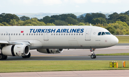 departing: Turkish Airlines Airbus A321 narrow-body passenger plane TC-JRN, Sariyer taxiing on Manchester International Airport tarmac after landing.