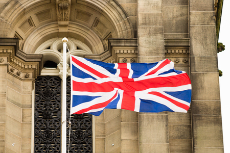 flag pole: Union Jack waving in the flag pole.