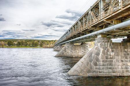 rovaniemi: Ounaskoski Bridge, one of the bridges in Rovaniemi, a small city in Finnish Lapland. HDR.