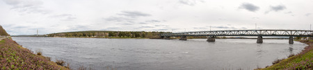 rovaniemi: Ounaskoski and Jatkankynttila Bridges, two bridges in Rovaniemi crossing Kemijoki, the longest river in Finland. Panorama. Stock Photo