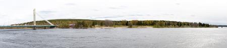Ounaskoski and Jatkankynttila Bridges, two bridges in Rovaniemi crossing Kemijoki, the longest river in Finland. Panorama. Stock Photo