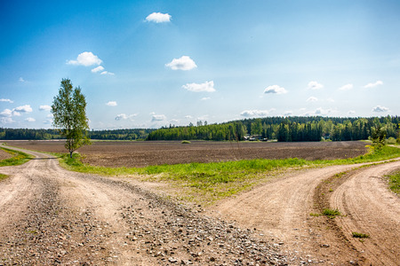 Branching road in Finnish countryside. Sunny weather. HDR. Stock Photo