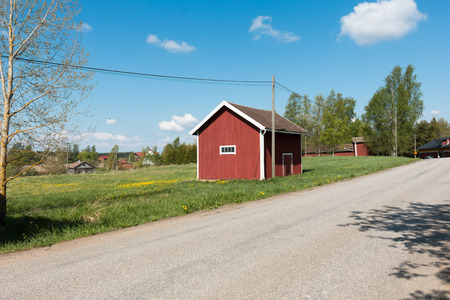 Red barn in rural Finland. Stock Photo