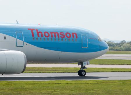 departing: Thomson Airways Boeing 767-300 (G-OBYG) wide-body passenger plane departing from Manchester International Airport.