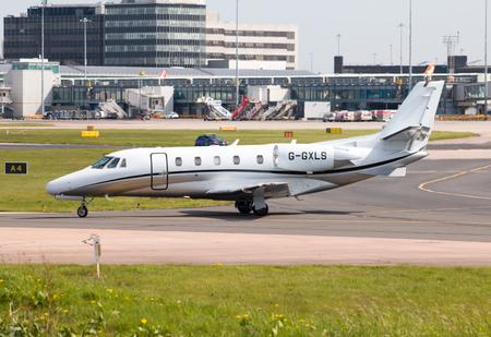 xls: Luxaviation Cessna Citation XLS business jet parket in Manchester International Airport tarmac.