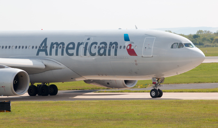american airlines: American Airlines Airbus A330 wide-body passenger plane (N288AY) taxiing on Manchester International Airport tarmac.