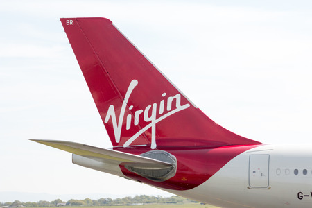 virgin girl: Virgin Atlantic Airbus A330-300 wide-body passenger plane (G-VGBR, Golden Girl) tailfin. Manchester International Airport.