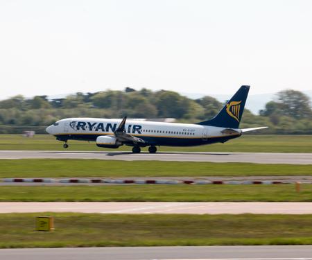 Ryanair Boeing 737-8AS narrow-body passenger plane (EI-EFF) taking off from Manchester International Airport runway.
