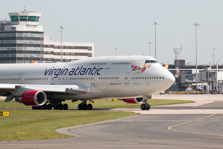 hot lips: Virgin Atlantic Boeing 747-400 wide-body passenger plane (G-VLIP, Hot Lips) taxiing on Manchester International Airport tarmac. Editorial