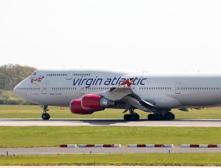 hot lips: Virgin Atlantic Boeing 747-400 wide-body passenger plane (G-VLIP, Hot Lips) taking off from Manchester International Airport runway.