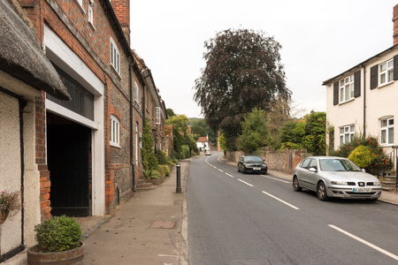 A street in Streatley, a village and civil parish in Berkshire, England, United Kingdom. Overcast weather.
