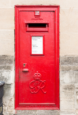 royal mail: Traditional red British mailbox in old town of Oxford, England. Editorial
