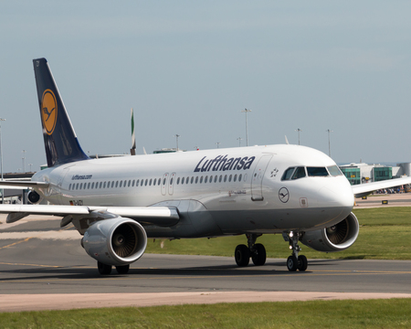 Lufthansa A319-100 narrow-body passenger plane (D-AIZY) taxiing on Manchester International Airport tarmac. Editorial