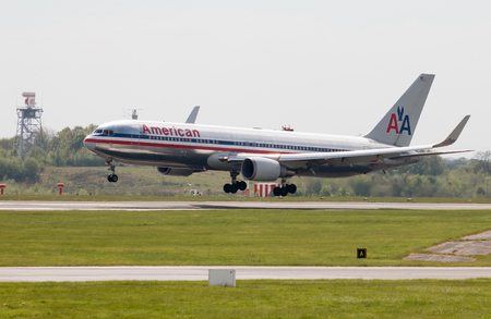 american airlines: American Airlines Airbus A330 wide-body passenger plane (N362AA) landing to Manchester International Airport runway.