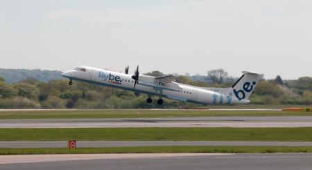 turboprop: Flybe Bombardier Dash 8 Q400 twin-engine, medium range, turboprop passenger plane (G-JECP) taking off from Manchester International Airport runway.