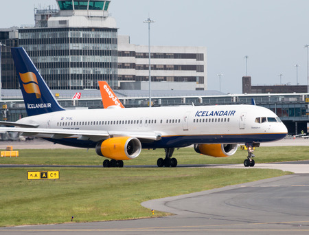 Icelandair Boeing 757-200 narrow-body passenger plane (TF-ISL) taxiing on Manchester International Airport tarmac. Editorial