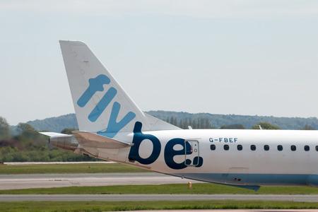 stabilizer: Flybe Embraer ERJ-195LR narrow-body medium-range twin-engine jet airliner (G-FBEF) vertical stabilizer, Manchester International Airport.