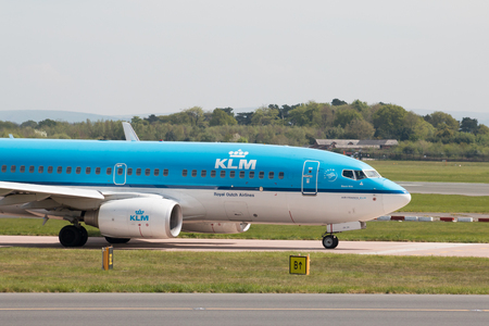 KLM Boeing 737-7K2 narrow-body passenger plane (PH-BGR) taxiing on Manchester International Airport tarmac. Editorial