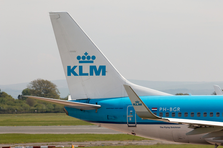 stabilizer: KLM Boeing 737-7K2 narrow-body passenger plane (PH-BGR) vertical stabilizer, Manchester International Airport.
