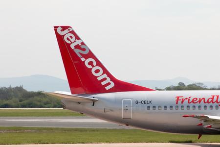 stabilizer: Jet2 Boeing 737-330 narrow-body passenger plane (G-CELK) vertical stabilizer, Manchester International Airport.