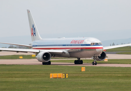 American Airlines Boeing 767-323(ER) wide-body passenger plane (N362AA) taxiing on Manchester International Airport tarmac. Editorial