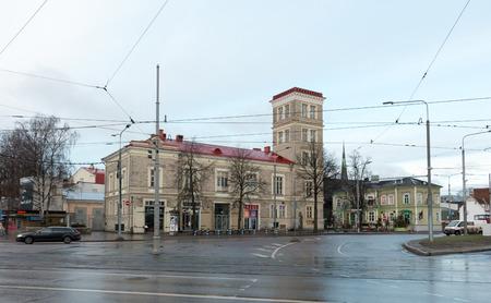 Historic architecture in busy Vana-Viru street in central Tallinn, capital of Estonia. Cloudy December morning. Redakční