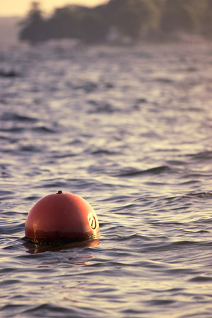glimpse: Got a glimpse of the sunset and buoy together. Stock Photo