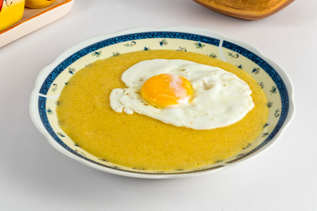Cornmeal dish with a fried egg