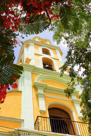 Ancient architectural colonial construction, photo framed with the vegetation; It is at present a museum of the fight against bandits in Trinidad Cuba