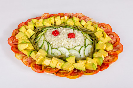 Vegetable salad with cabbage, cucumber, bean, tomato and avocado and two red pepper adorned with