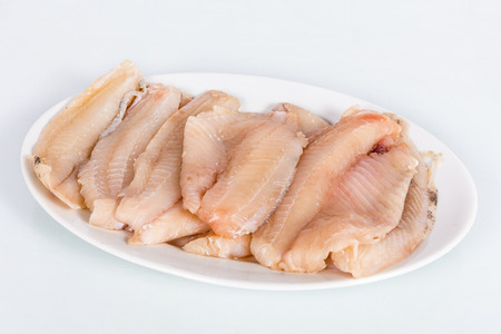 oreochromis: Fillets of raw fish specifically of Oreochromis Niloticus. Grouped in a dish